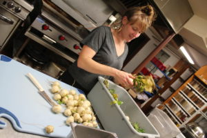 Chef Liz preps turnips in the Sterling Kitchen